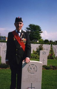 Joe at a Black Watch grave, June 2009